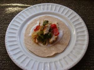 Chicken fajita on a white plate