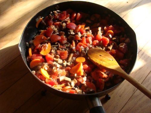 Filling for vegetarian moussaka in a cast-iron skillet