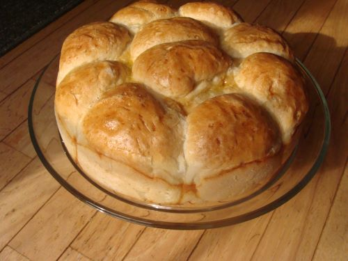 A round batch of pogacha rolls on a plate