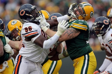 A Chicago Bears football player and a Green Bay Packers football player in a fight