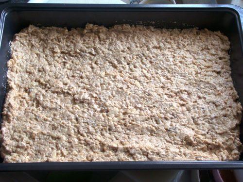 Apple Pie Cake batter spread in a rectangular baking pan