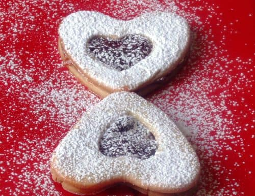Two heart-shaped Linzer cookies