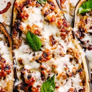 Sausage stuffed eggplants covered in melty cheese.