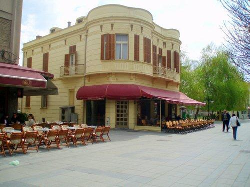 The front of a Macedonian bakery with tables and chairs out front