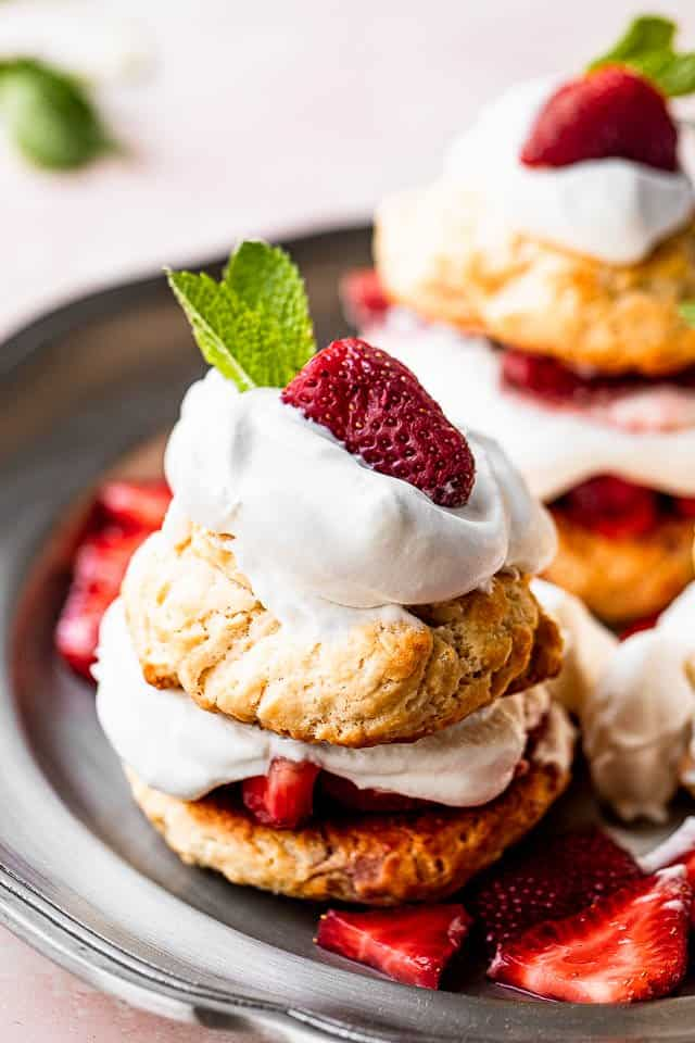 top view of strawberry shortcakes topped with whipped cream and mint