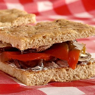 Roasted Red Pepper Sandwiches with Herbed Goat Cheese Served on Focaccia Bread