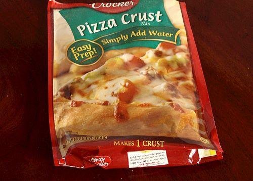 A red and green pouch of pizza crust mix