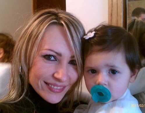 Close-up photo of a mom and baby girl with a pacifier