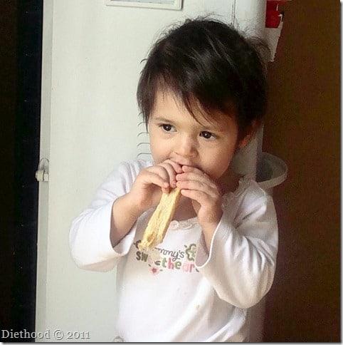 Ana eating mustard batons