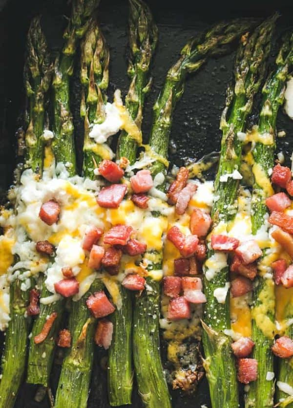 Garlic Roasted Asparagus with Bacon and Cheese - Our Garlic Roasted Asparagus is made with just a few simple ingredients, PLUS bacon and cheese,  and makes for a delicious side dish with any meal!