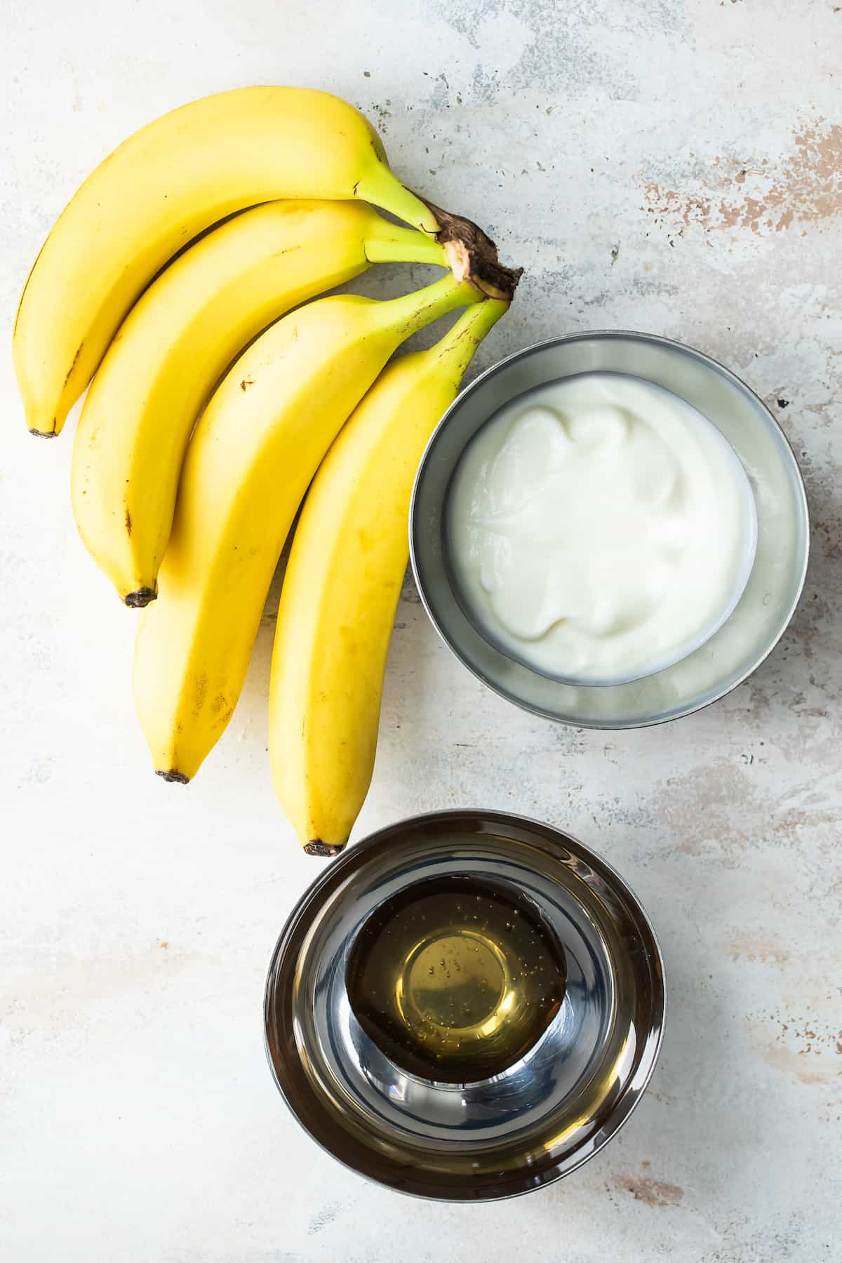Ingredients for banana frozen yogurt.