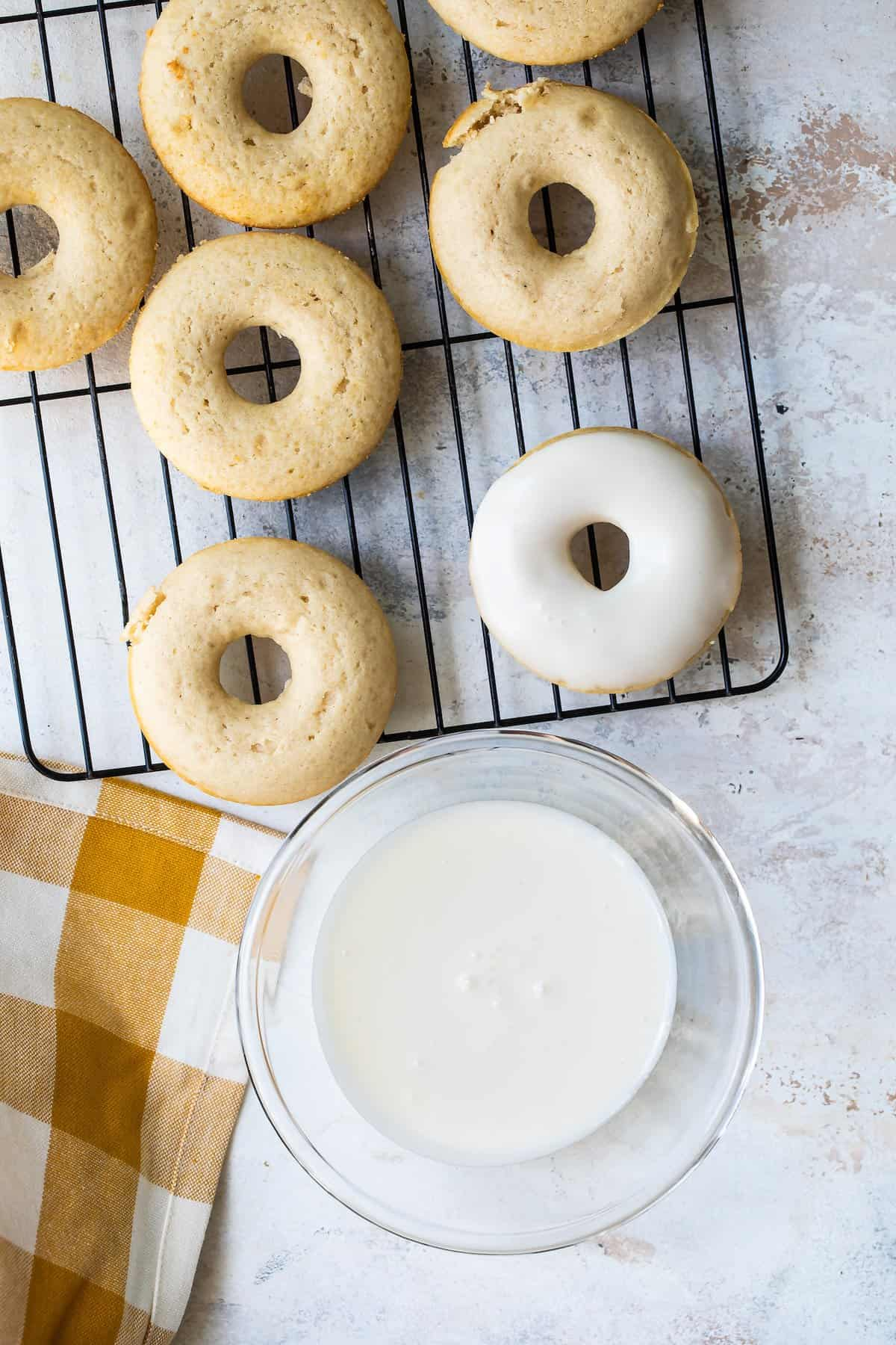 Cooling rack with cinnamon baked donuts.
