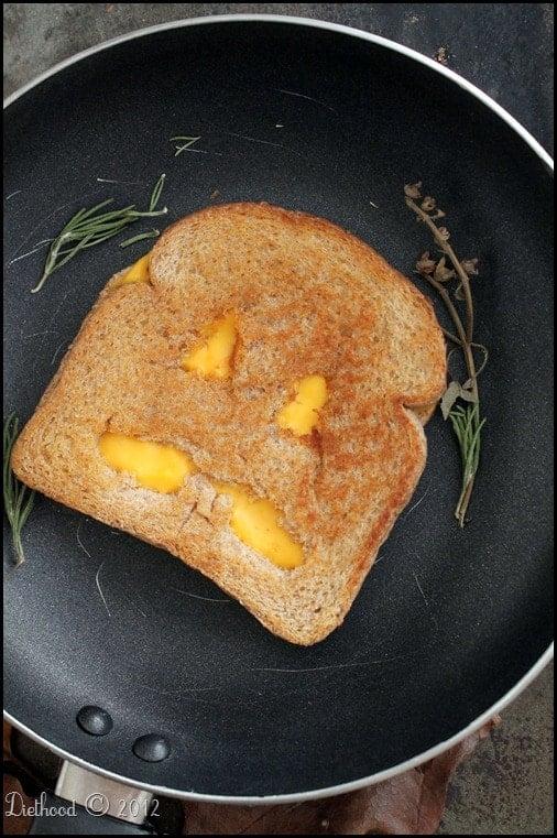 Jack O Lantern Grilled Cheese Sandwich via Diethood
