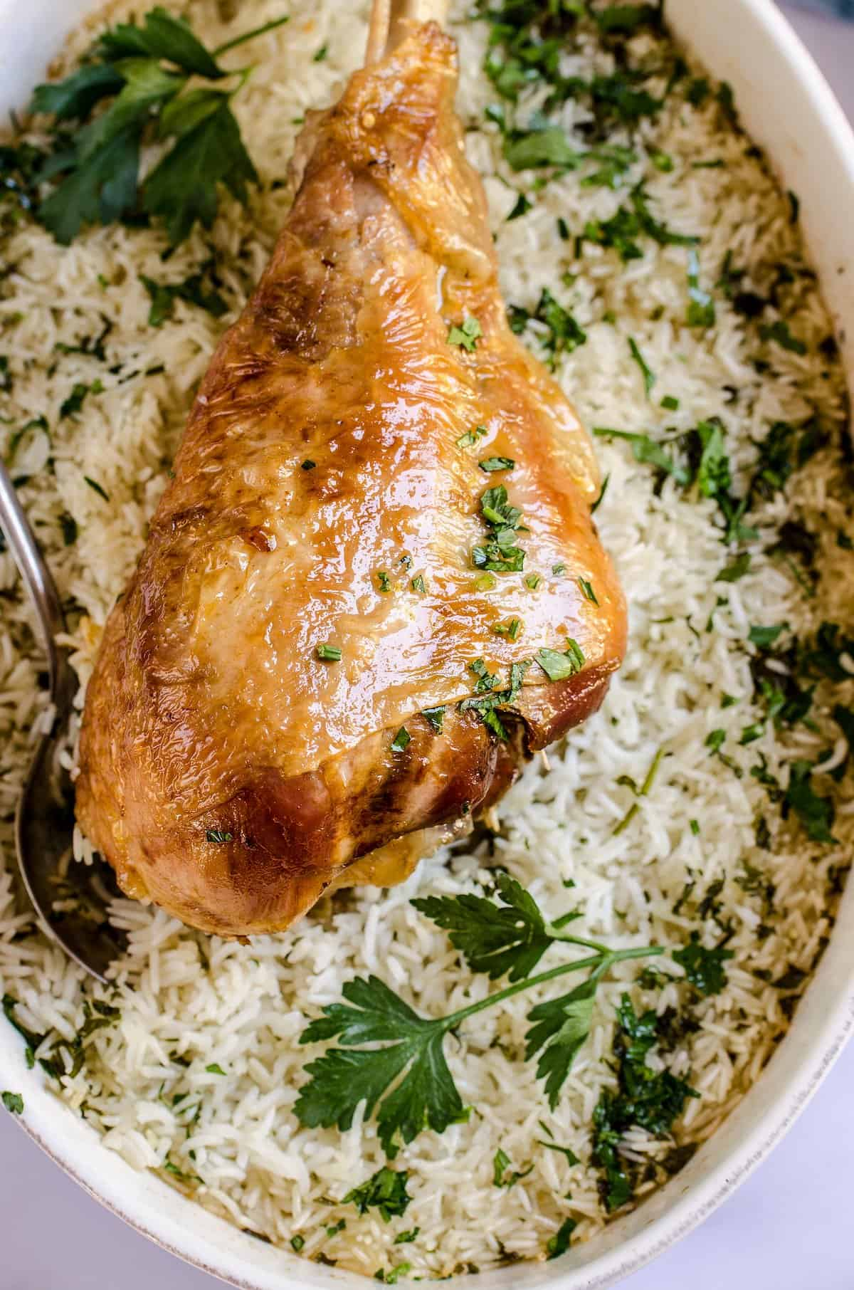 Turkey and long grain rice in a baking dish.