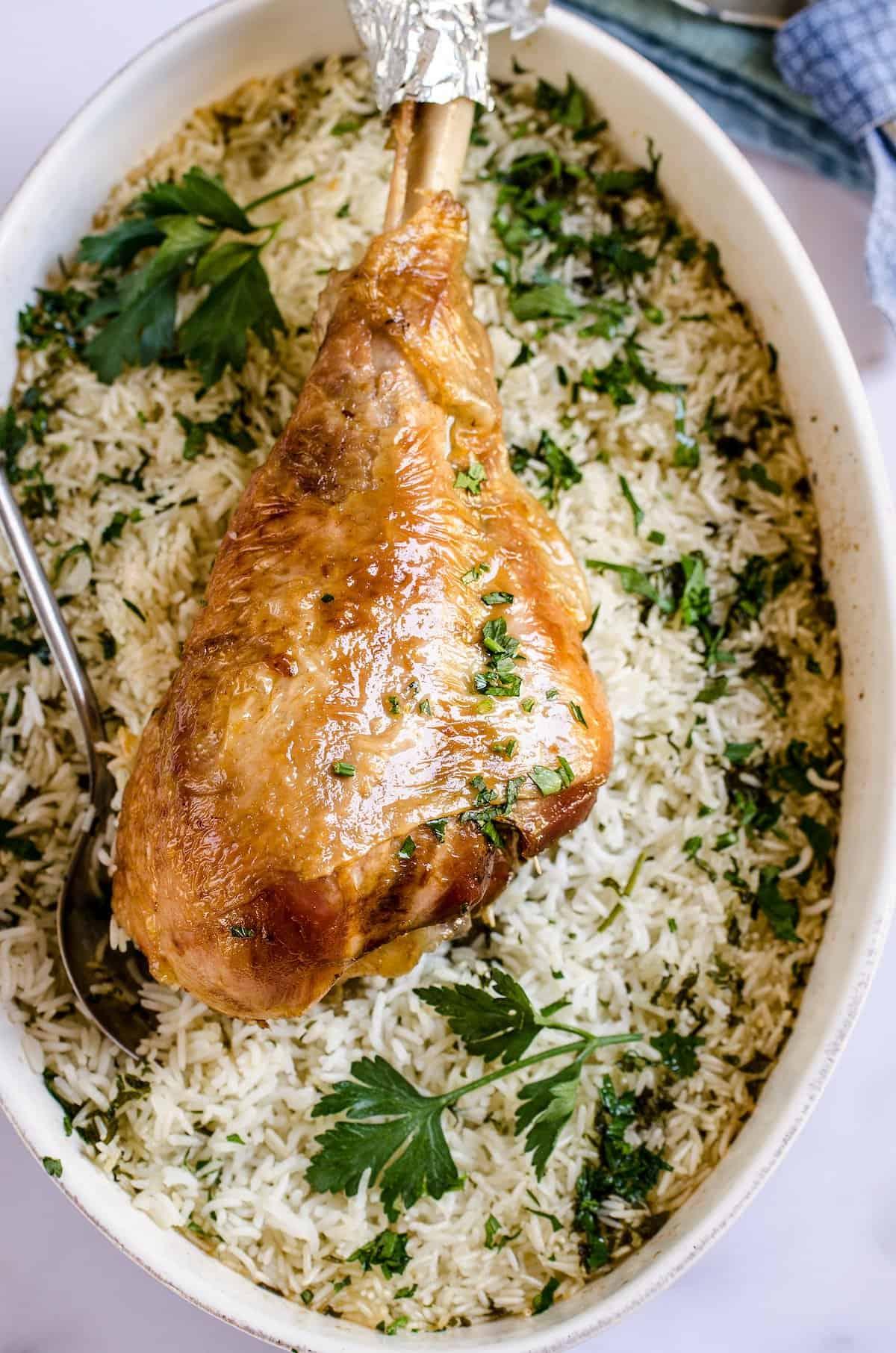 A turkey leg over seasoned rice.
