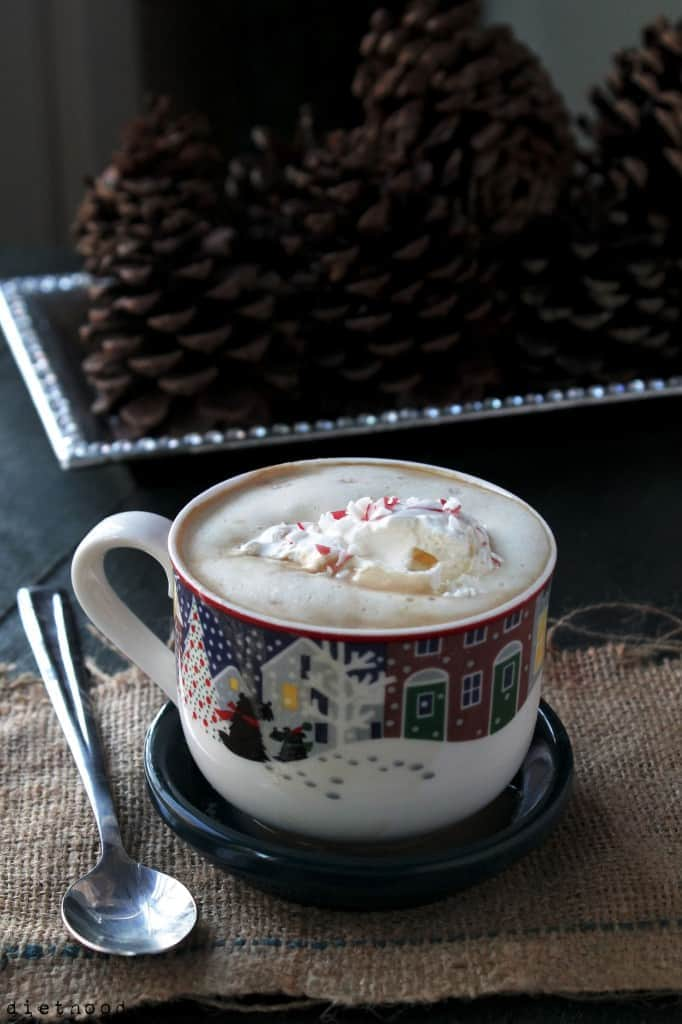 A festive mug filled with Peppermint White Chocolate Mocha Latte with crushed peppermint on top