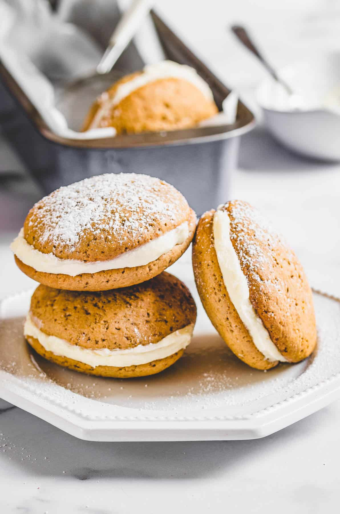 Three whoopie pies on a plate.