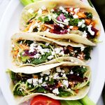 Shredded Buffalo Chicken Tacos - Stuffed with the most incredible and spicy chicken, and loaded with a delicious broccoli slaw and feta cheese, this recipe is a must-have for busy weeknights!