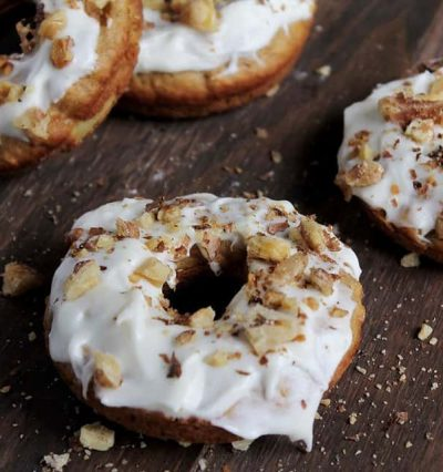 Baked Carrot Cake Doughnuts | www.diethood.com | Baked Carrot Cake Doughnuts frosted with Pineapple Cream Cheese Frosting and topped with Toasted Walnuts | #recipe #doughnuts #carrotcake #dessert