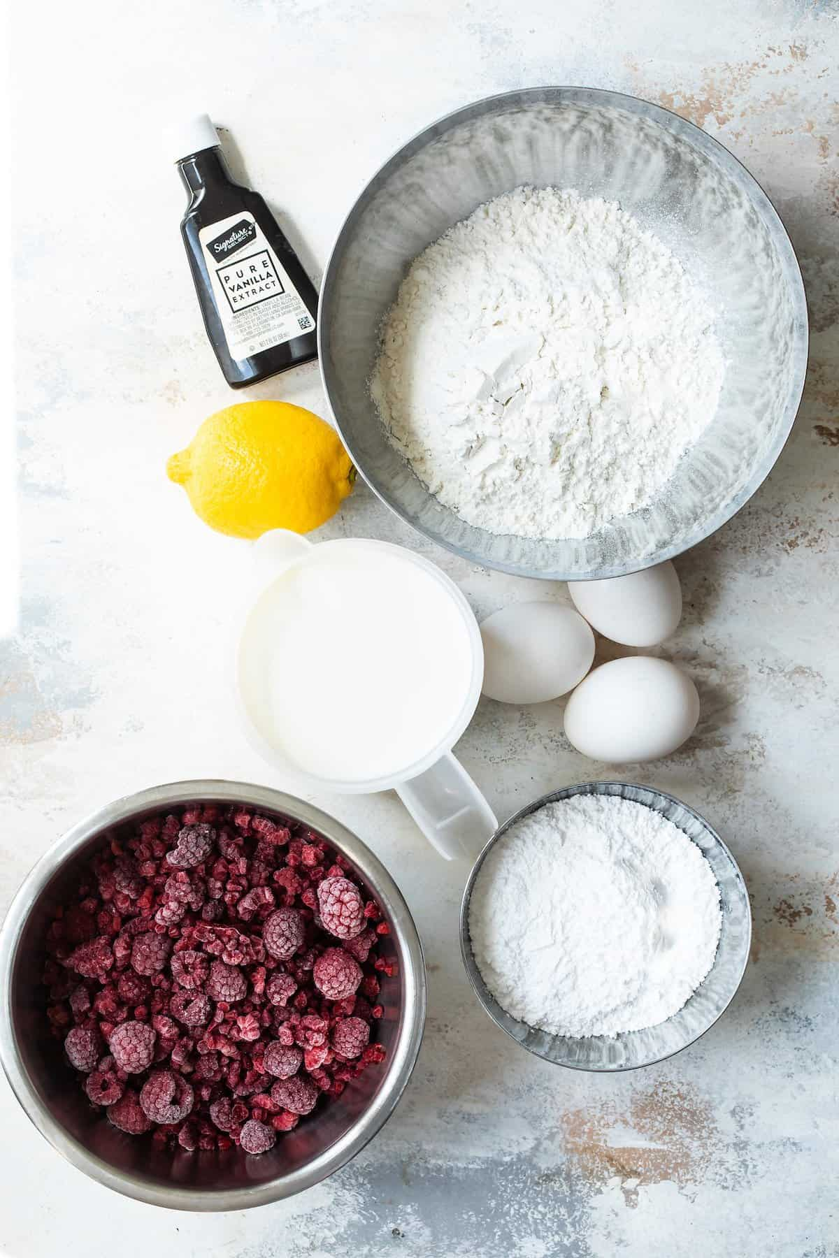 Ingredients for lemon crepes with raspberry sauce.