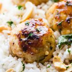 Cashew Chicken Meatballs - Seasoned and nutty chicken meatballs served with a side of sweet and sour sauce.