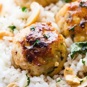 Cashew Chicken Meatballs - Seasoned and nutty chicken meatballs served with a side of sweet and sour sauce.