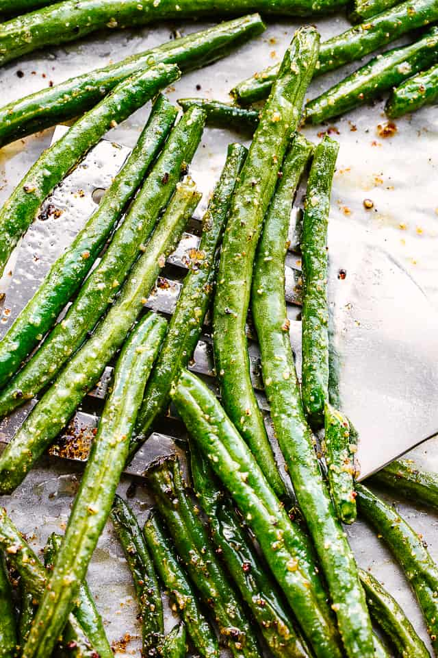 Roasted green beans on a tray.
