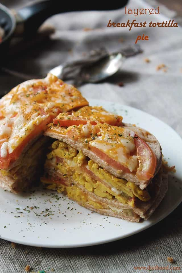 Layered Breakfast Tortilla Pie | www.diethood.com | Stacked layers of tortillas filled with seasoned eggs, cheese, and tomatoes | #recipe #breakfast #cincodemayo