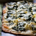 Spinach and Artichoke Dip Pizza | www.diethood.com | Homemade pizza crust topped with spinach, cream cheese, and artichokes | #recipe #pizza #dinner