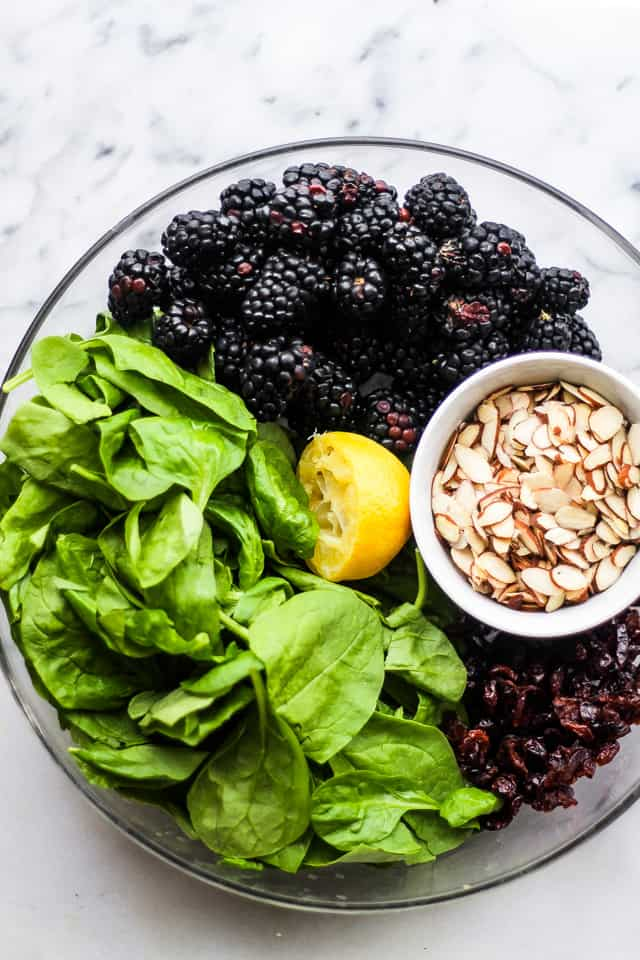 Spinach Blackberry Salad - A delicious and nutritious blend of power greens, sweet blackberries, and almonds tossed in a lemon poppyseed dressing!