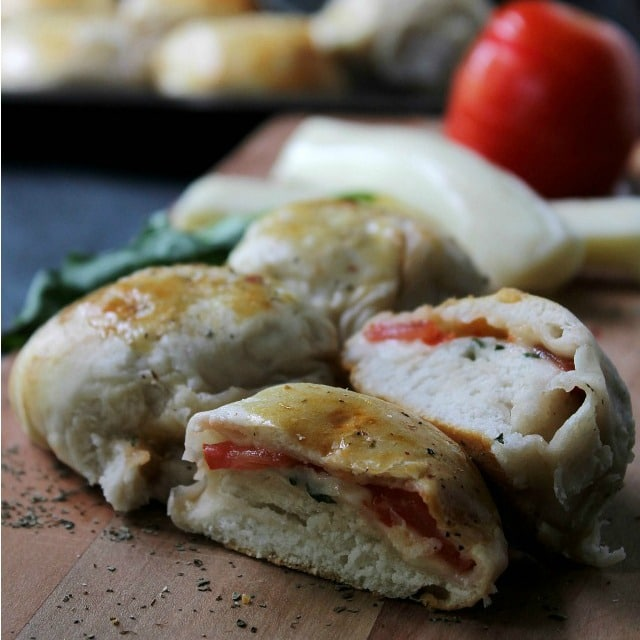 Caprese Pizza Rolls | www.diethood.com | Soft and flavorful ready-to-bake biscuits filled with a delicious Caprese mixture of sliced tomatoes, shredded mozzarella, and basil. | #recipe #pizza #caprese