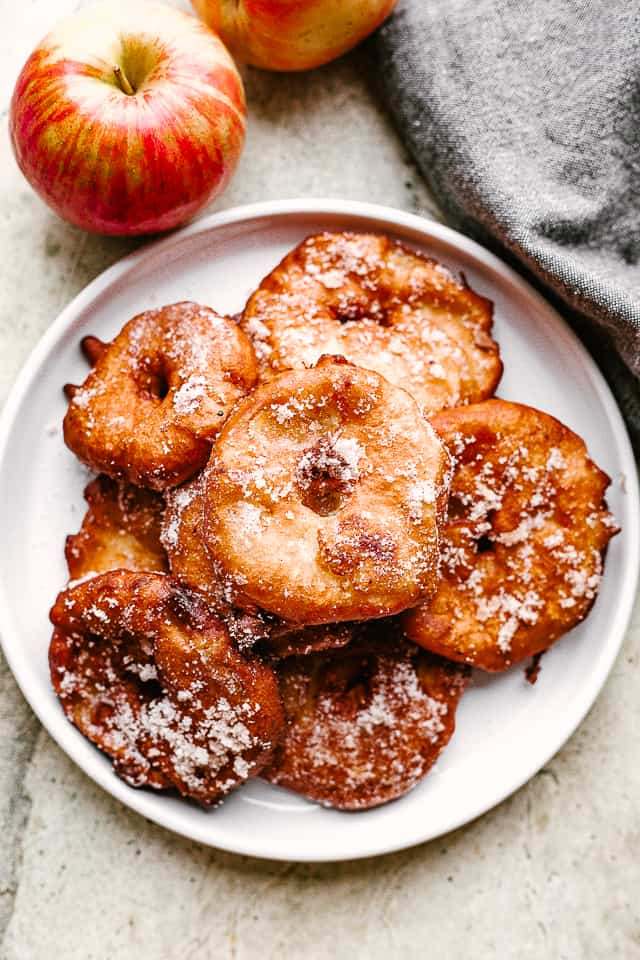 Fried Apple Rings stacked on a plate.