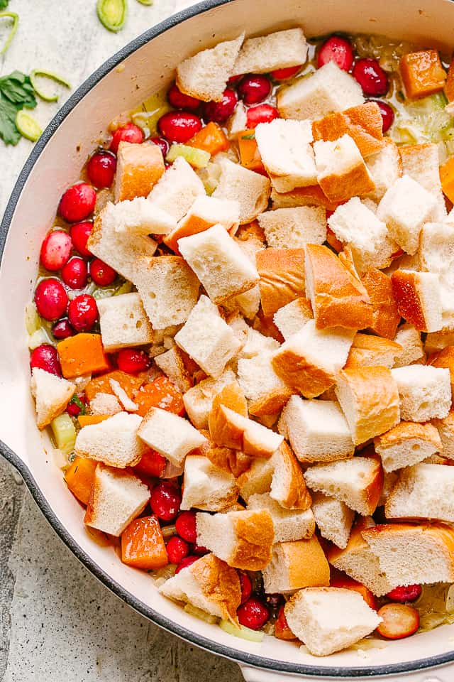 Dry bread cubes over cranberries and sweet potatoes.