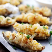 Garlicky Cheesy Crispy Potato Skins | www.diethood.com | Garlicky and Cheesy Crispy Potato Skins topped with three cheeses, sour cream, crushed croutons and green onions. | #recipe #appetizers #potatoskins