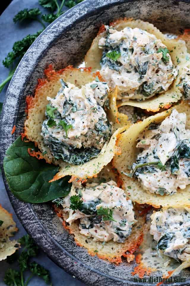 Spinach and Artichoke Dip Parmesan Cups served on a pewter plate