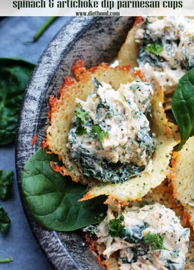 Spinach Artichoke Dip Served In Cheese Cups on a platter