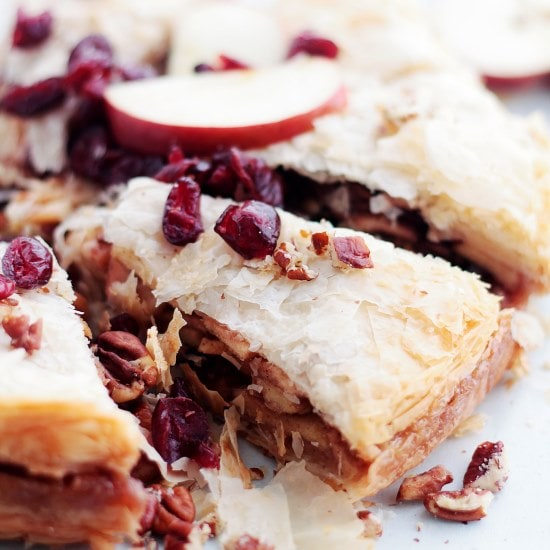 Apple Strudel Cake | www.diethood.com | This beautiful Apple Strudel Cake is a fun take on the classic Apple Strudel dessert, filled with a deliciously spiced apple cranberry filling.