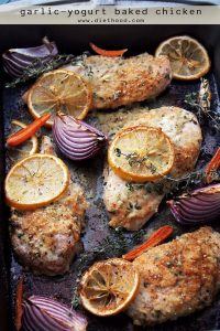 Garlic Yogurt Baked Chicken - Flavorful, delicious baked chicken, marinated in yogurt with garlic and thyme. Your new favorite din din!