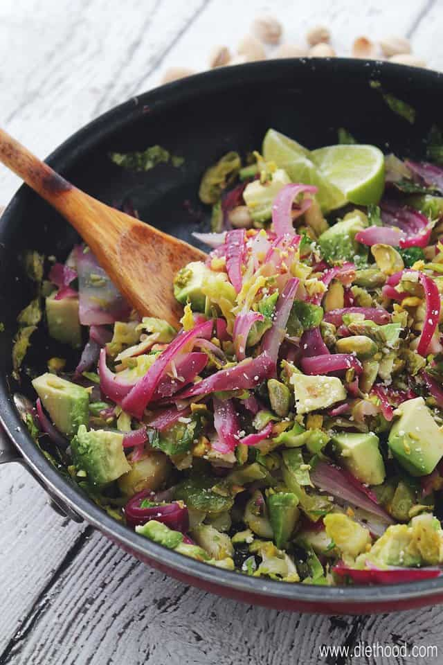 Shaved Brussels Sprouts Salad with Avocado and Pistachios | www.diethood.com | Hearty, healthy, and incredibly delicious sauteed salad packed with Shaved Brussels Sprouts, Red Onions, Avocado, Pistachios and a splash of lime juice. | #PistachioHealth #ad