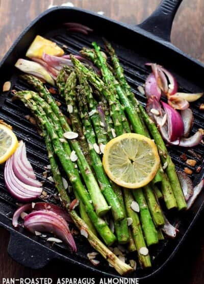 Pan Roasted Asparagus Almondine - Asparagus spears sauteed with almonds, red onions and lemon slices.