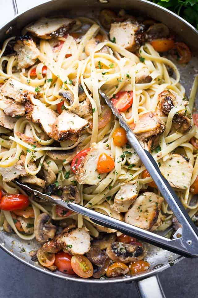 Lemon Chicken Fettuccine - This one pot Lemon Chicken Fettuccine is a fresh and easy take on dinner, tossed with tomatoes, mushrooms, lemon juice and olive oil.