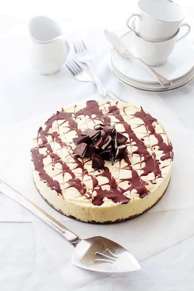 Mint Chocolate New York Style Cheesecake | www.diethood.com | Silky New York Style Cheesecake filled with delicious pieces of Mint Chocolate. | #recipe #cheesecake #chocolate
