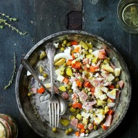 Russian Layered Salad | www.diethood.com | Russian Layered Salad is a delicious salad recipe made with ham, eggs, cheeses, carrots, peas, and pickles. | #recipes #memorialday #salad #russiansalad
