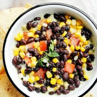 Southwestern Avocado Dip at Diethood | www.diethood.com | Layered Southwestern Avocado Dip made with a smooth avocado mixture, black beans, sweet corn and tomatoes. | #recipe #avocados #appetizer