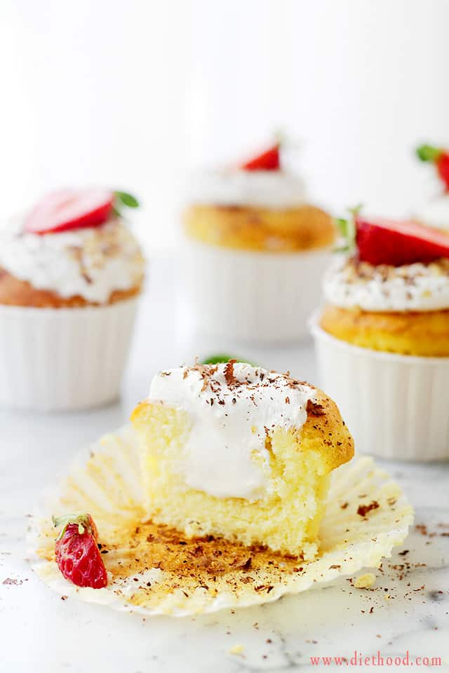 Ice Cream Filled Vanilla Cupcakes | www.diethood.com | Sweet Vanilla Cupcakes are filled with Vanilla Ice Cream and topped with a Whipped Cream Frosting. | #recipe #cupcakes #icecream