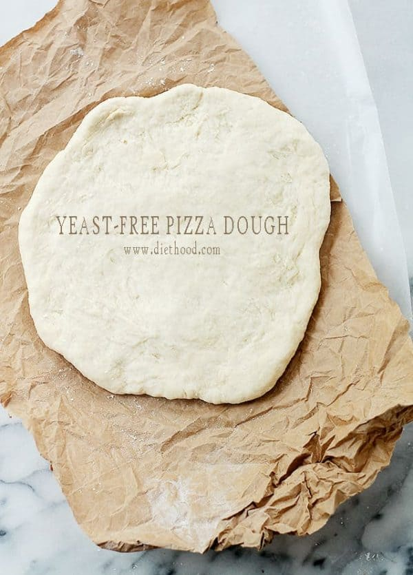 Yeast-Free Pizza Dough: Fast and simple recipe for Pizza Dough made without yeast that is delicious and SO easy to make! Besides... ain't nobody got time for that dough to rise.