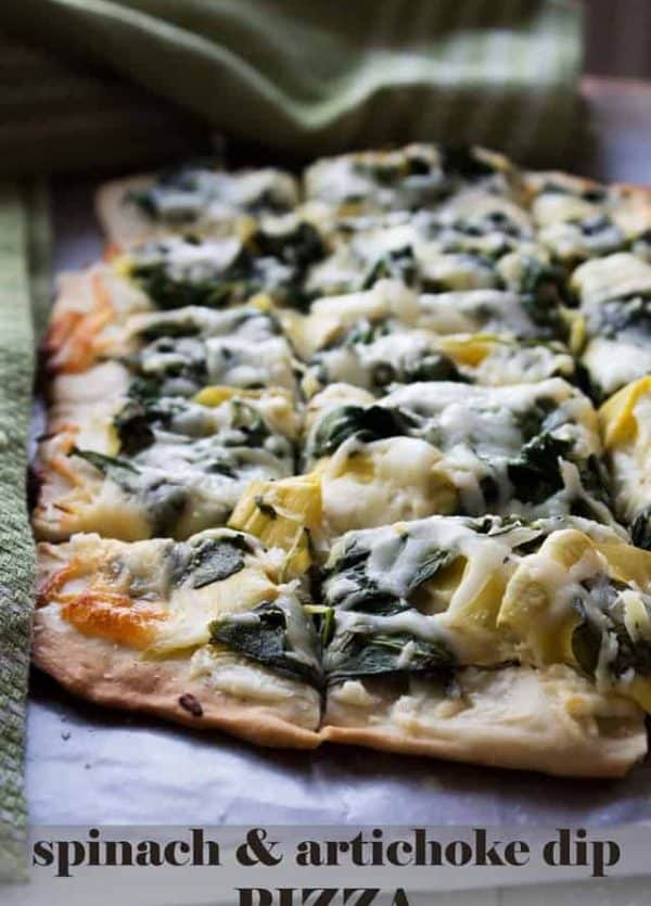 Spinach and Artichoke Dip Pizza - Homemade pizza crust topped with the best combination for dip including, cream cheese, spinach, and artichokes.