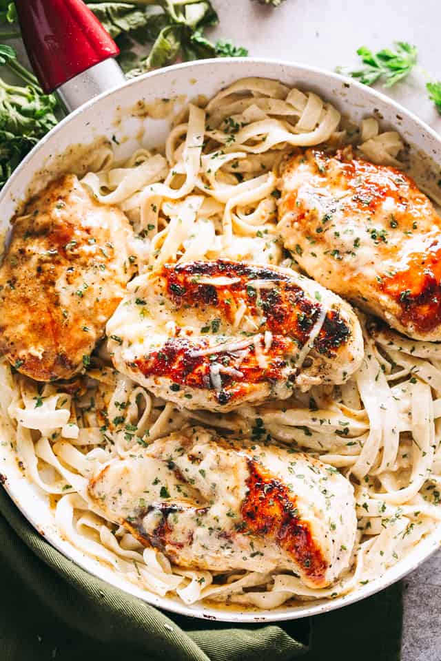Skinny Chicken Fettuccine with Alfredo Sauce: Creamy and delicious lightened up Chicken Fettuccine prepared with a lighter and flavorful Alfredo Sauce.