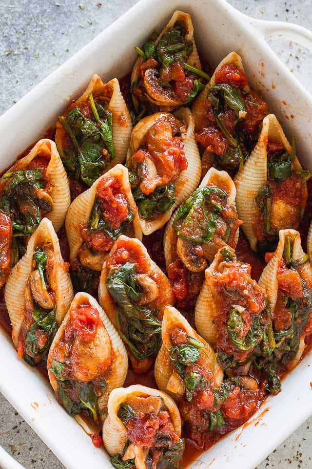 Pasta shells stuffed with spinach mushroom sauce
