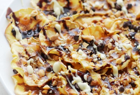 Caramel Apple Chips Nachos | www.diethood.com | Crispy, homemade Apple Chips topped with caramel, melted chocolate, and peanuts.